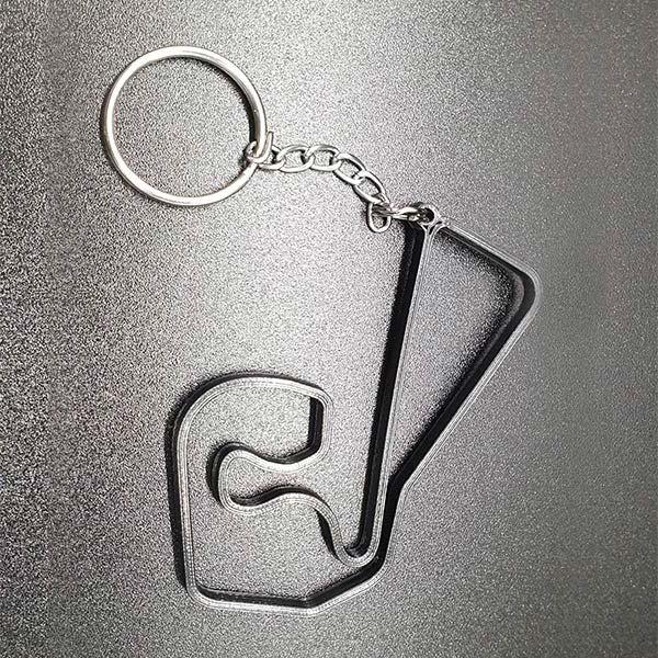 Rennstrecke Sachsenring Moto GP, stylischer Schlüsselanhänger für Motorsportfans, aus strapazierfähigem Nylon mit Schlüsselring, Grösse ca. 8 cm.